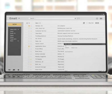 Emails on a laptop screen isolated on an desk, office background